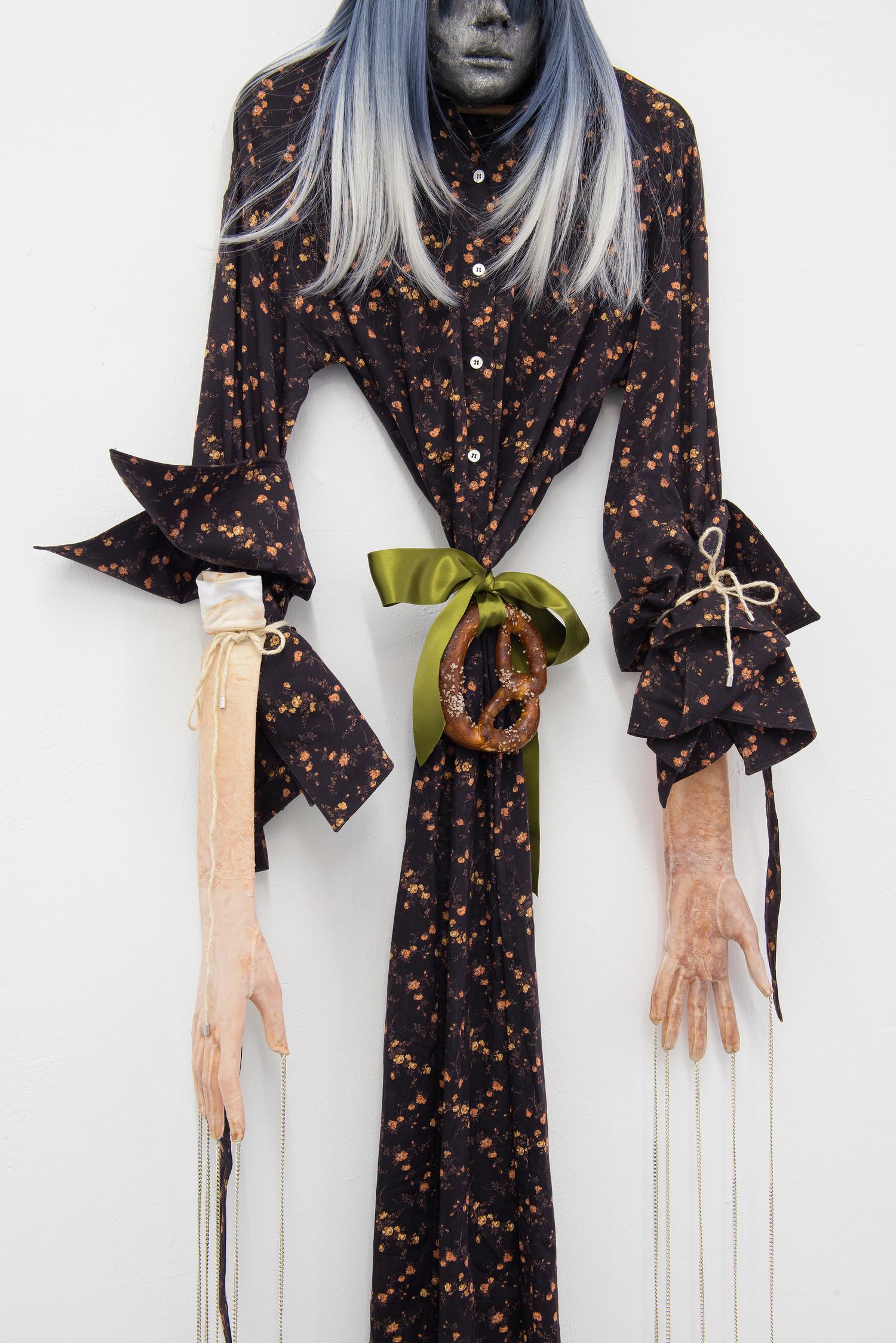 Witch (details), 2020, latex, textile, wig, bretzel, rope, chains, circa 188 x 54 x 15 cm — © Manon Wertenbroek