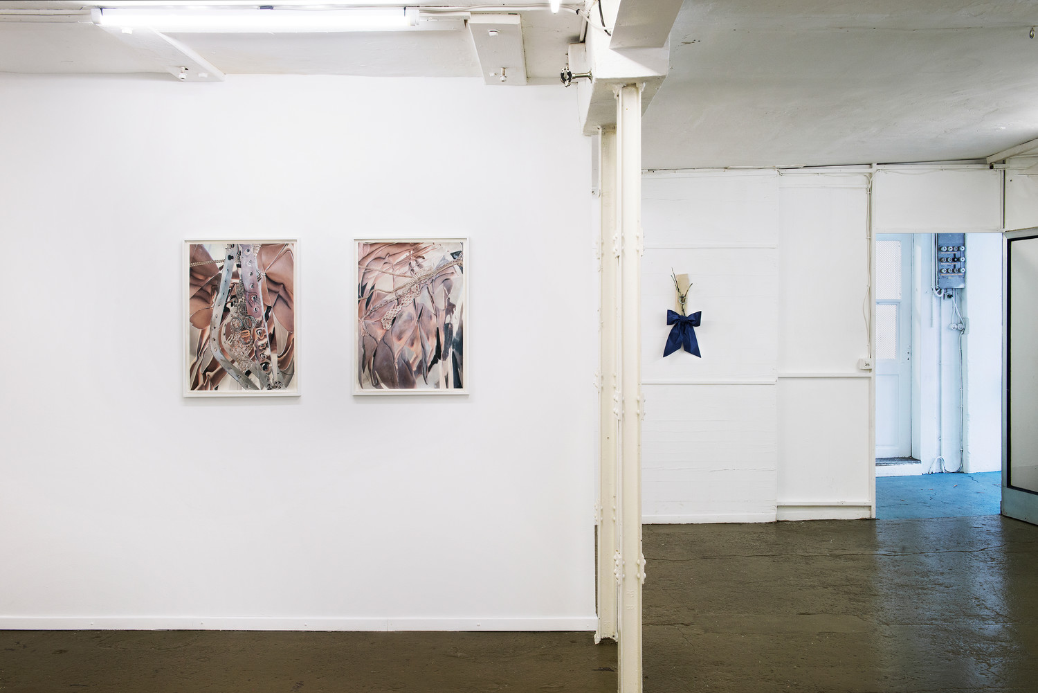 On the left: Manon Wertenbroek, Self-portrait 1 & 2, 2020, ink, acrylic and pencil on paper, framed, each 75 x 55,5 x 3 cm, On the right: Roman Gysin, Welcome Home II, 2018, wood, fabric, glue, chalk, 45 x 23 x 17 cm — © Manon Wertenbroek